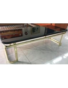 Tavolino da salotto rettangolare con basamento in metallo ottonato e piano in legno laccato nero lucido